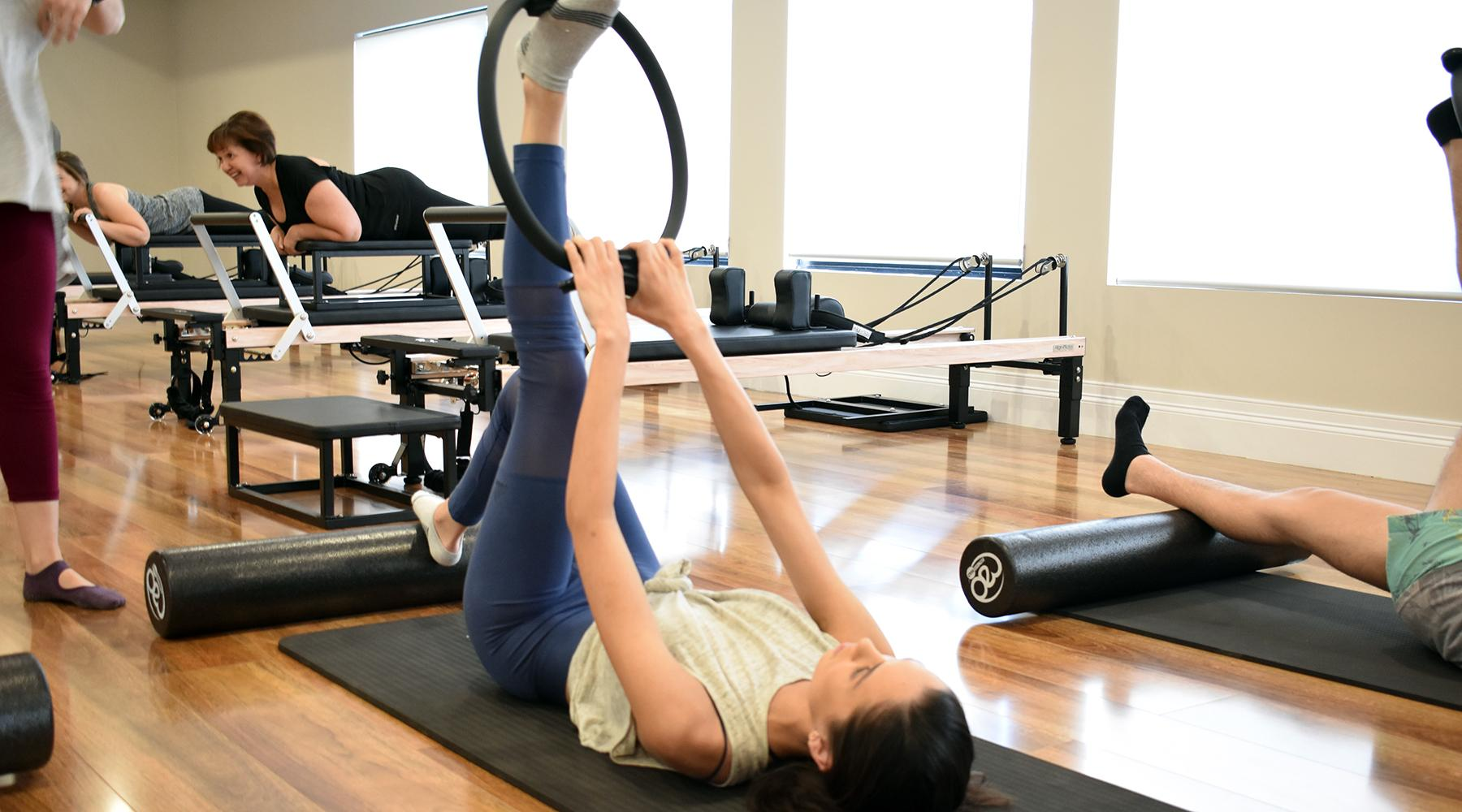 Semprose Pilates and Fitness - lady laying on the yoga mat doing some exercise